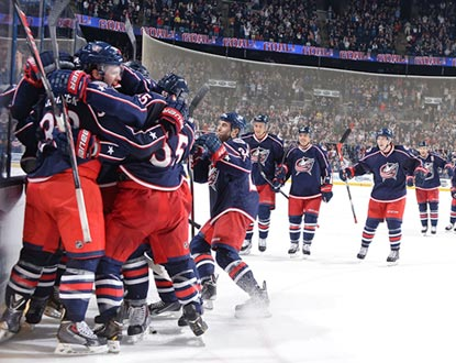 The Blue Jackets stream onto the ice to celebrate Ryan Johansen's overtime goal, which gives Columbus its 41st victory.  (Getty Images)