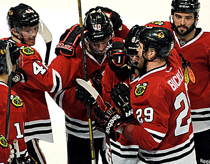Chicago's Patrick Sharp celebrates hitting the game-winner 43 seconds into overtime against the Canadiens. (USATSI)