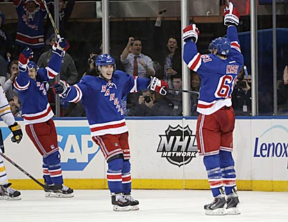 Rick Nash (61) celebrates his go-ahead goal, which helps New York grab the second seed in the Metropolitan Division playoffs. (Getty Images)