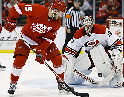 Cam Ward makes the stop for the Carolina Hurricanes, one of his 28 saves against the Detroit Red Wings. (USATSI)