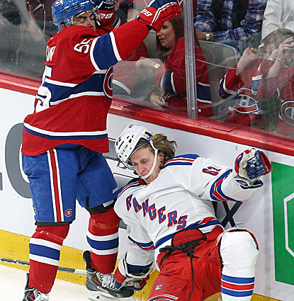Montreal's Francis Bouillon gets the best of this exchange with Carl Hagelin and the Habs get the best of the Rangers. (USATSI)