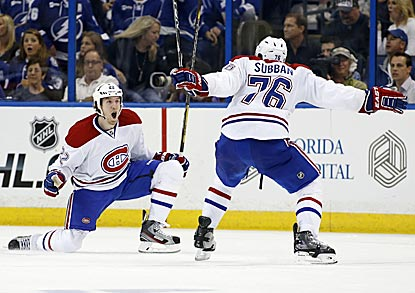 Montreal's Dale Weise (left) celebrates with P.K. Subban after scoring in overtime.  (Getty Images)