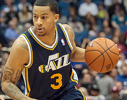 Utah's Trey Burke scores a career-high 32 points to go with nine assists and seven rebounds. (USATSI)