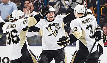 Jussi Jokinen (36) celebrates his goal, which completes Pittsburgh's comeback and puts it ahead to stay.  (Getty Images)