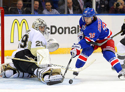 Marc-Andre Fleury makes one of his 35 saves, this one against New York's Mats Zuccarello in the third period. (USATSI)