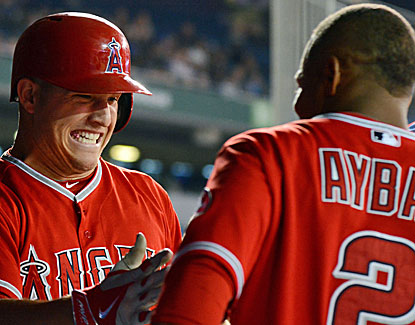 Angels slugger Mike Trout celebrates his homer with Erick Aybar, who also enjoys a big night. (USATSI)