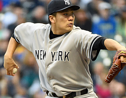 New York's Masahiro Tanaka (5-0) allows two runs and strikes out seven in his first interleague game. (USATSI)