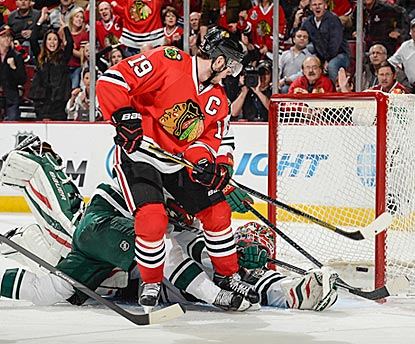 Jonathan Toews converts a rebound with a backhand shot past Ilya Bryzgalov in the third period for the winning goal.  (Getty Images)