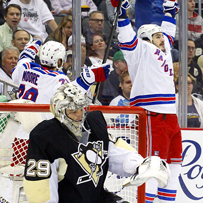 Brian Boyle (right) celebrates after scoring a goal against Penguins goalie Marc-Andre Fleury (bottom). (USATSI)