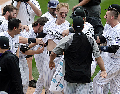 Colorado's Justin Morneau hits a two-run homer in the 10th inning, the sixth walk-off homer of his career. (USATSI)