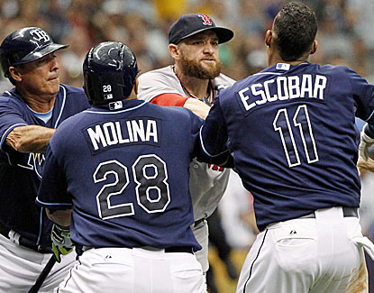 Boston's Jonny Gomes rushes in from the outfield and escalates a touchy situation with Yunel Escobar. (USATSI)