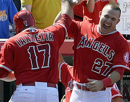 Chris Iannetta gets some love from Mike Trout after hitting a tiebreaking home run in the eighth inning. (USATSI)