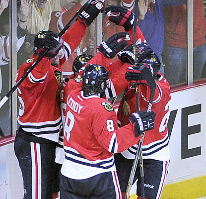 The defending champion Blackhawks rejoice after it scores the winner in double overtime to make it 3-2 in the Western finals. (USATSI)