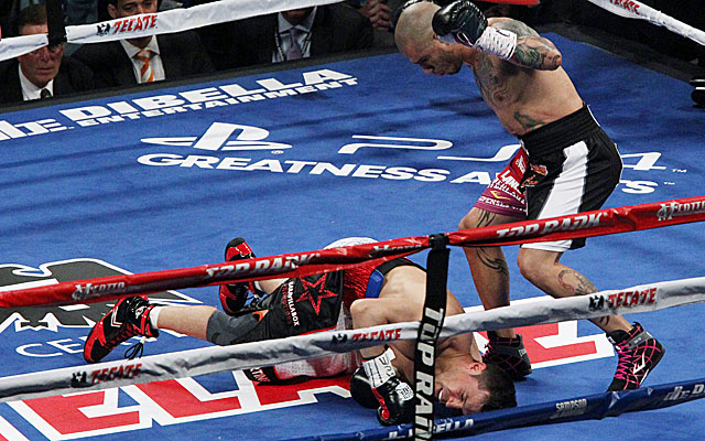 Miguel Cotto knocks down Sergio Martinez in the first round en route to improving to 39-4. (USATSI)