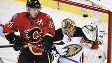 Flames beat Ducks in OT