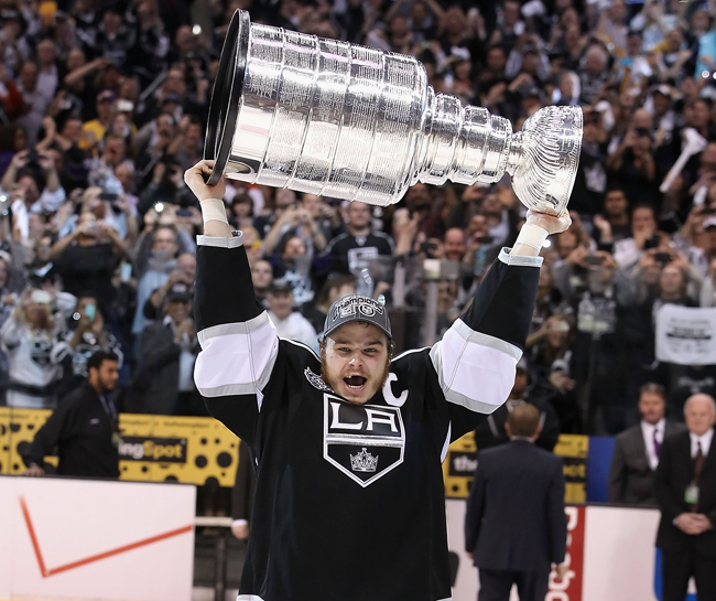 Dustin Brown lifts the Stanley Cup. (Getty)