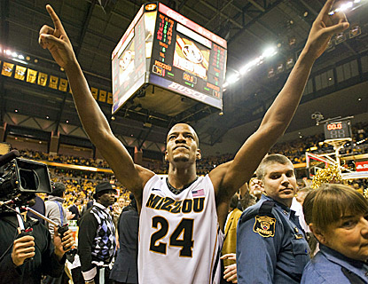 Missouri's Kim English, who scores 18 points in the Tigers' 74-71 win over Kansas, walks off the court satisfied. (AP)