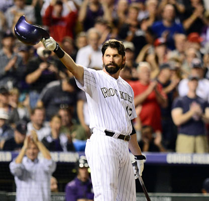 Todd Helton goes out in style in front of his fans, hitting a homer and driving in three in his last game at Coors Field.  (USATSI)