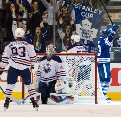 Dave Bolland scores in overtime to complete Toronto's dramatic comeback in front of its ecstatic home fans.  (USATSI)