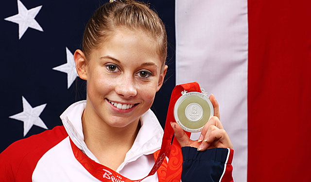 Shawn Johnson displays her all-around silver medal from the Beijing Olympics. (Getty Images)