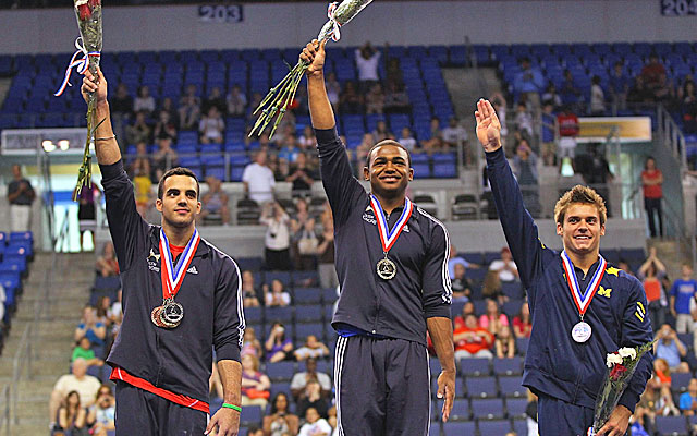 Gold medalist John Orozco tops the medal stand, flanked by Danell Leyva and Sam Mikulak. (Getty Images)
