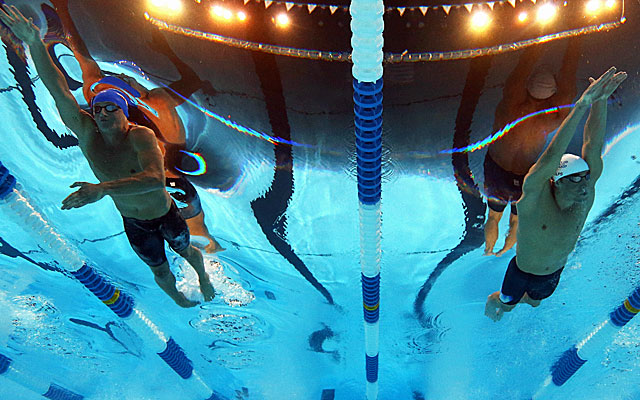 Phelps (right) goes through a hectic night, also competing in the 200 butterfly. (Getty Images)