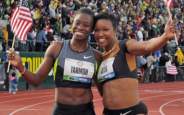 Believing she qualified for London, Jeneba Tarmoh celebrated with 100m winner Carmelita Jeter. (US Presswire)