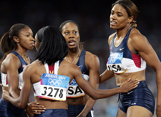 Cox (far right), who ran in the Athens preliminaries for the U.S., has been stripped of her gold. (Getty Images)