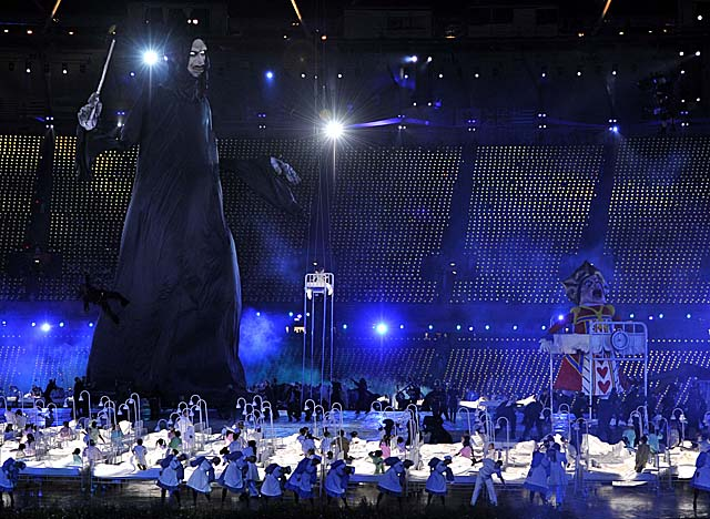 A giant puppet of Lord Voldemort looms over children in a skit at opening ceremonies. (Getty Images)