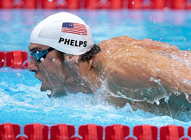 Phelps wins his morning heat at the Aquatics Center, but barely qualifies for the 400 IM final. (Getty Images)
