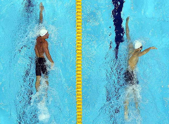Lochte (left) finishes second to Sun (right), trailing by 21/100ths of a second. (Getty Images)