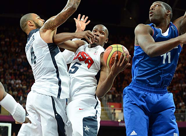 The U.S. works the boards, finishing with 56 to France's 40 and dominating the ORs 18-9. (Getty Images)