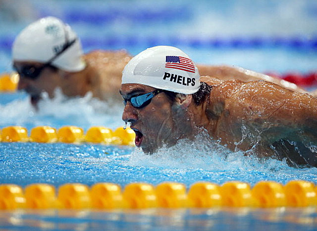 Phelps finishes third in his heat on Monday morning, good for fifth overall in 200 fly qualifying. (Getty Images)