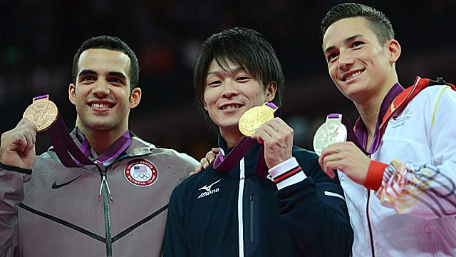 Danell Leyva (left) rallies to finish behind Kohei Uchimura and Marcel Nguyen. (Getty Images)