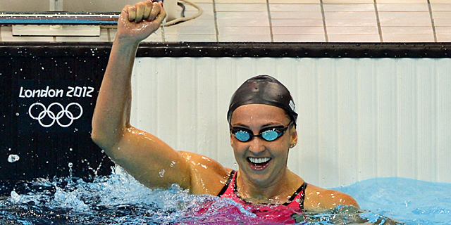 Soni celebrates after setting her world record to reach the 200-meter breaststroke final. (Getty Images)