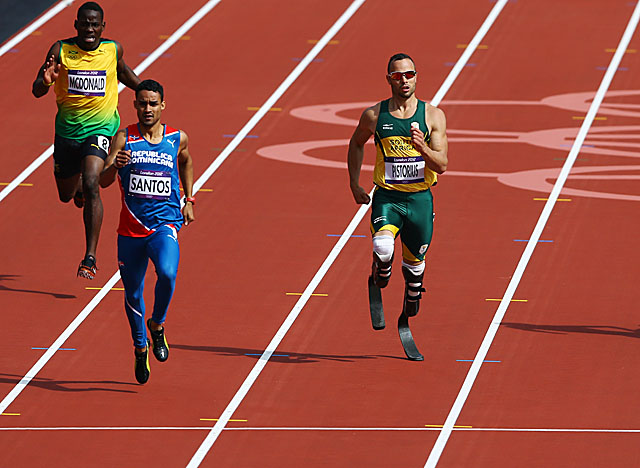 After cruising by a couple of opponents, Pistorius coasts to a second-place finish in his heat. (Getty Images)
