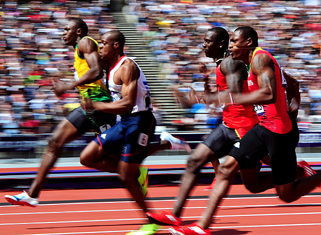 Bolt (far left) overcomes a slow start in Heat 4 to win with a time of 10.09 seconds. (Getty Images)