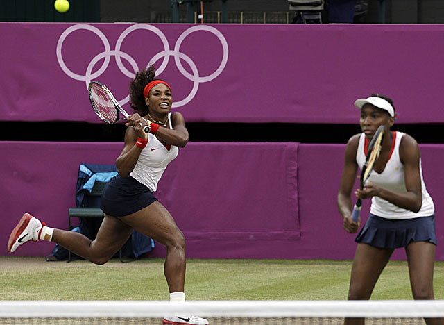 The Williamses didn't drop a set through their five Olympics doubles matches. (AP)