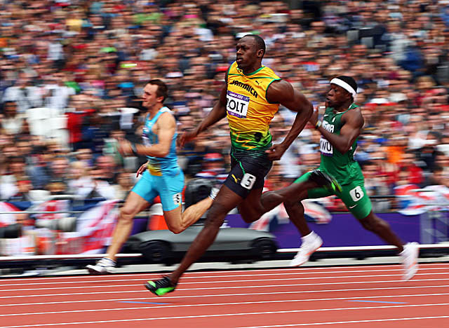 Bolt cruises through Tuesday's 200 qualifier and will defend his title Thursday. (Getty Images)