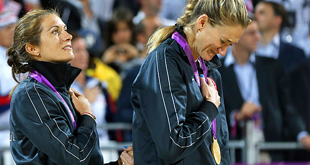 May-Treanor (left) and Walsh Jennings react while listening to the anthem during the medal ceremony. (AP)