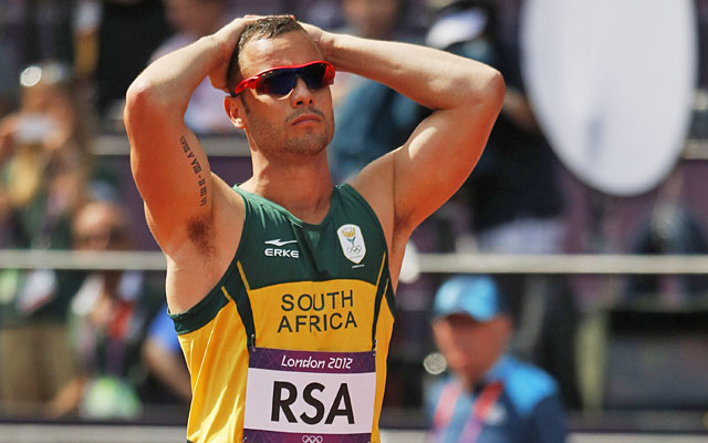 Oscar Pistorius left the track in disappointment after South Africa crashed out of its relay heat. (AP)