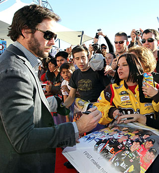 Jimmie Johnson signs autographs for fans at the Champions Week in Las Vegas. (Getty Images)