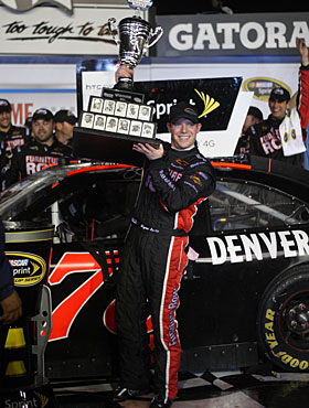Regan Smith, who previously had only one top 10, celebrates with his trophy. (AP)