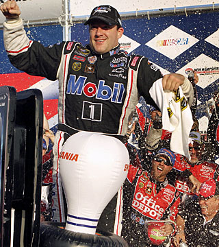 In a reversal of last year's race at Loudon, Stewart wins as Bowyer runs out of fuel with two laps to go. (AP)