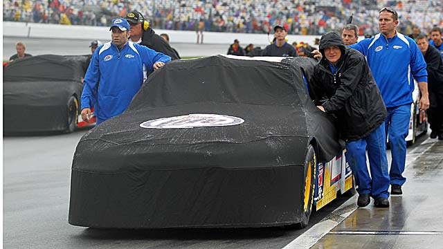 Brad Keselowski's crew moves his car to facilitate track drying during a rain delay. (Getty Images)