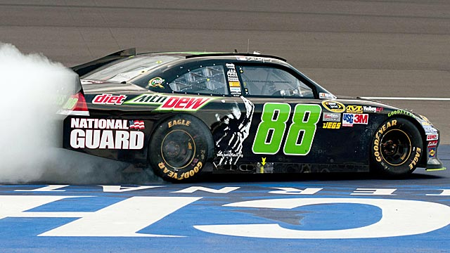 Dale Earnhardt Jr. burns the tires after ending his 143-Sprint Cup race winless drought. (US Presswire)