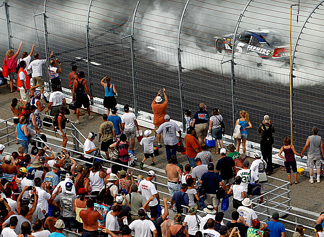 Earning his second victory of the season, Kahne does a burnout for fans at New Hampshire. (Getty Images)