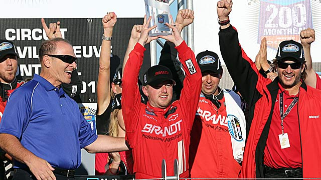 Justin Allgaier (center) celebrates his second 2012 victory with his Turner Motorsports team. (AP)