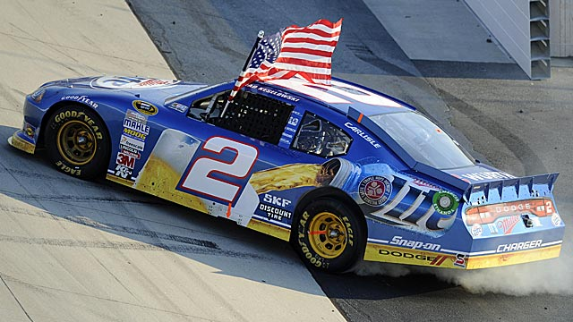 Brad Keselowski gets to do his winning flag ritual for the fifth time this season. (AP)