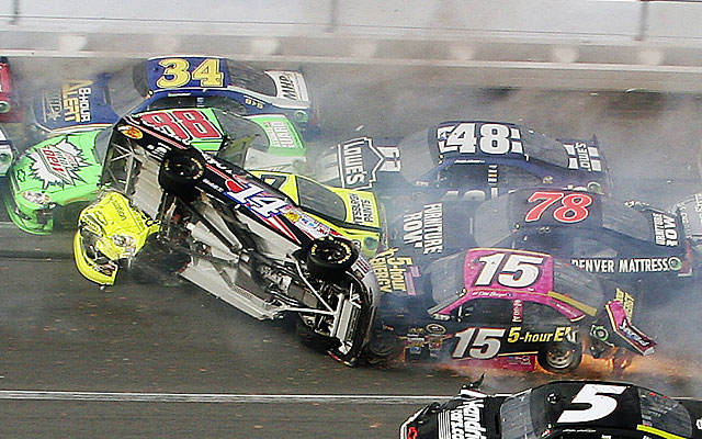 Tony Stewart (14) flips over during a crash on the final lap on Sunday. (AP)